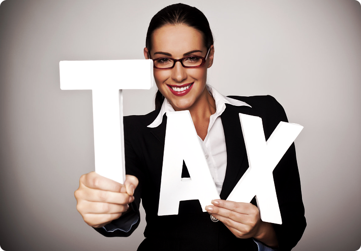 girl holding a TAX sign